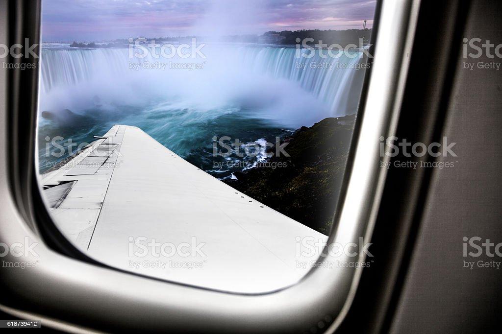 Niagara Falls at dusk - Canada from airplane window seat stock photo