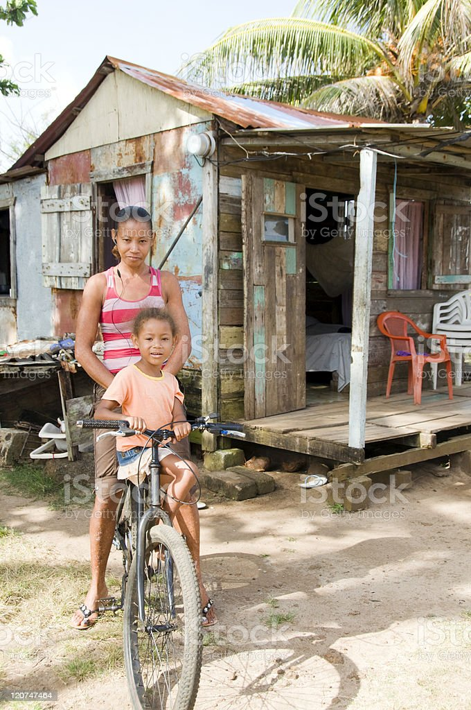 Nicaragua mother daughter bicycle poverty house Corn Island stock photo