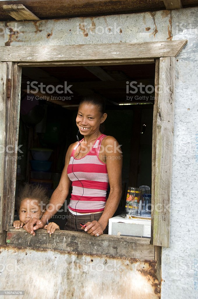 Nicaragua mother daughter  smiling poverty house Corn Island stock photo