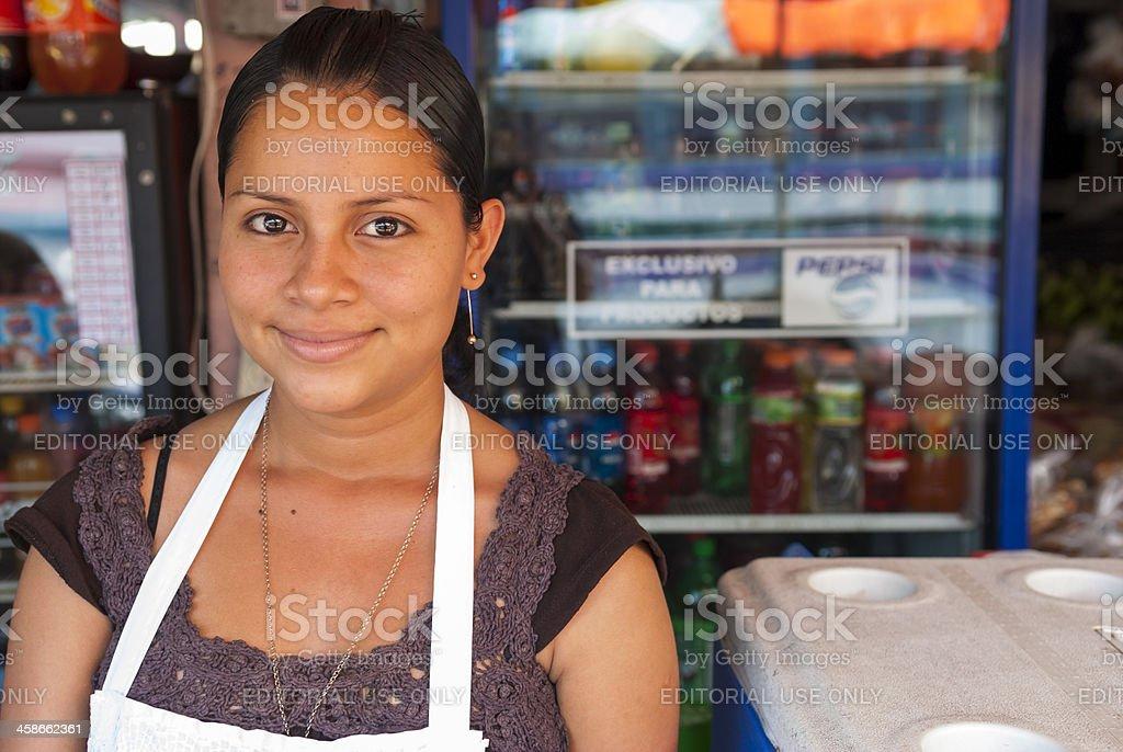Nicaraguan woman at store stock photo