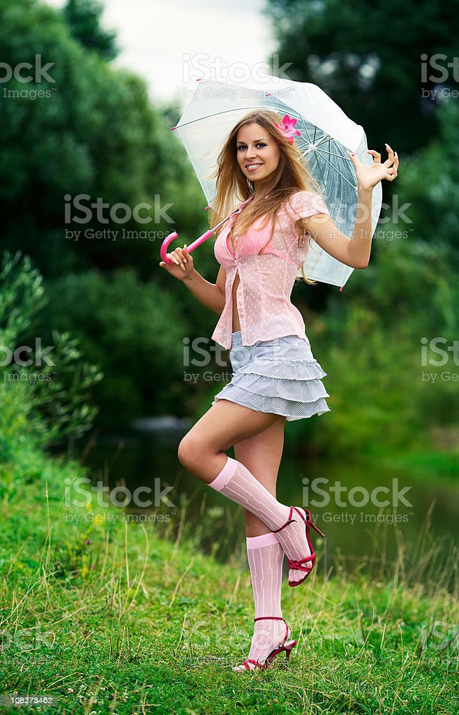 Nice and naughty girl under the umbrella royalty-free stock photo