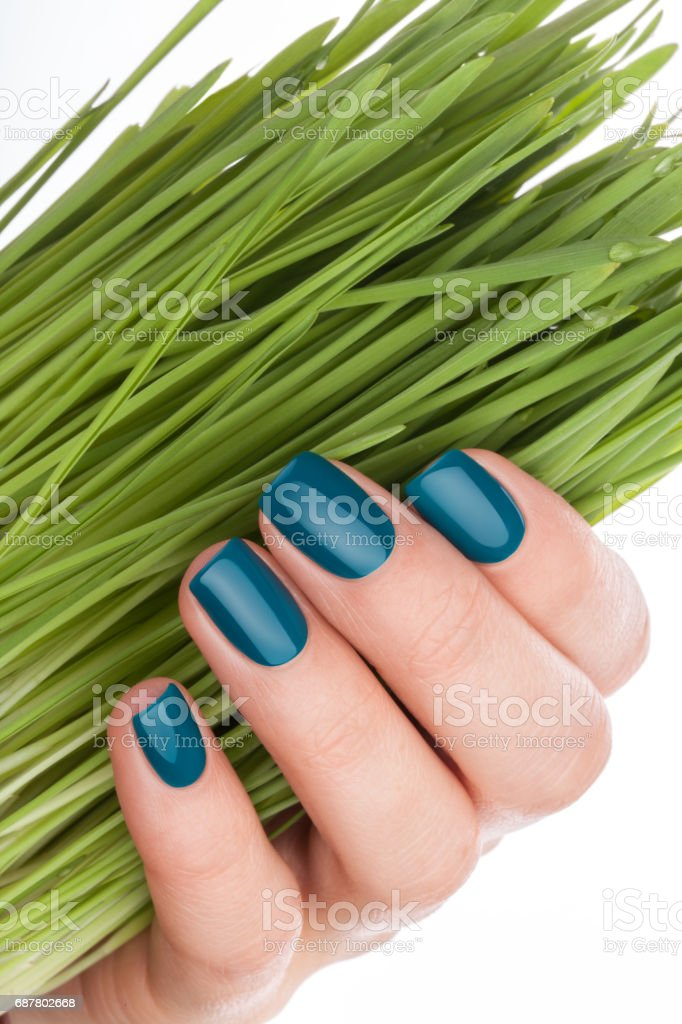 Nice and neat green nails. stock photo