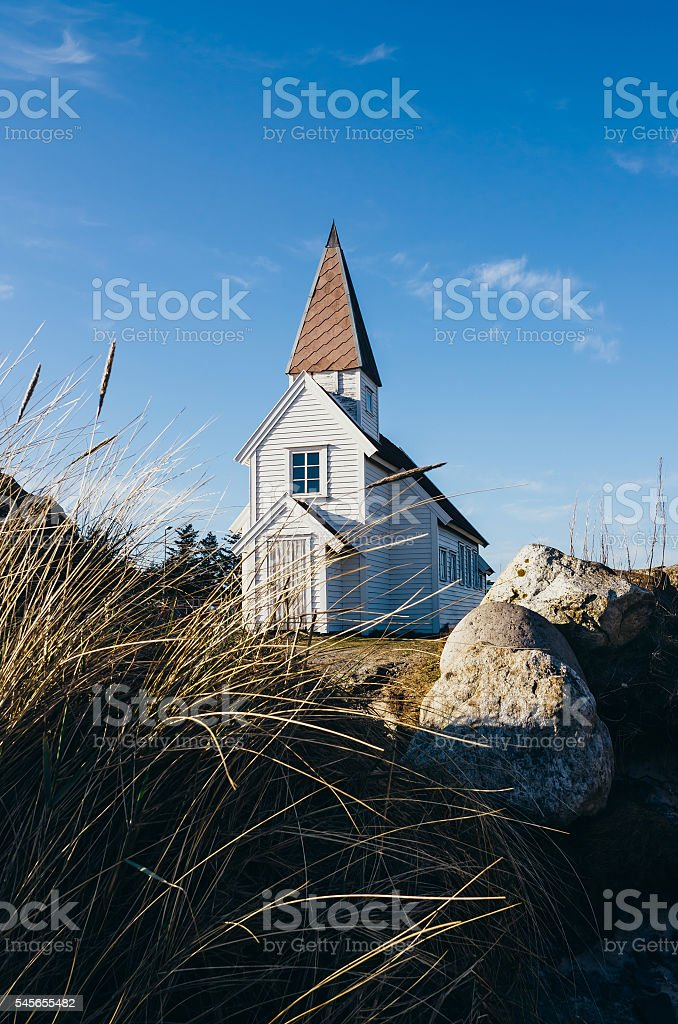 Nice and simple white wooden tradotional church in Norway. stock photo