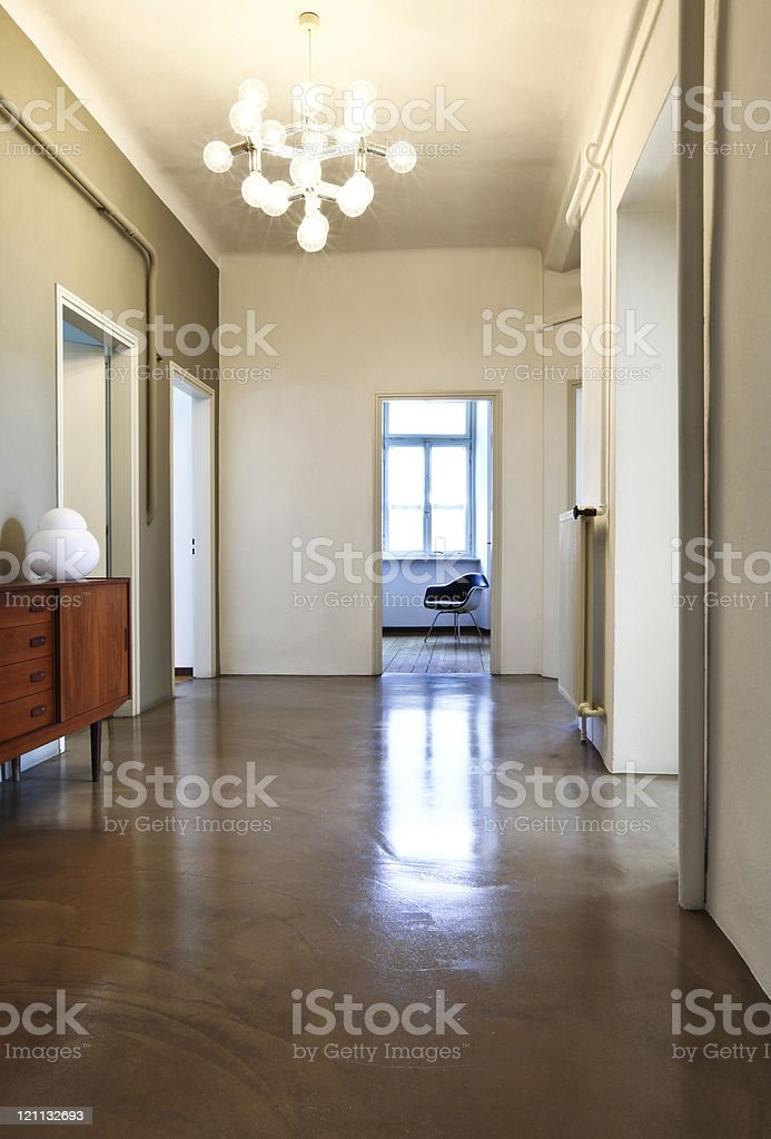 Nice apartment refitted, corridor with chandelier retro stock photo
