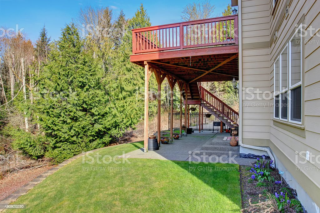 Nice back porch with covered patio and decorations.