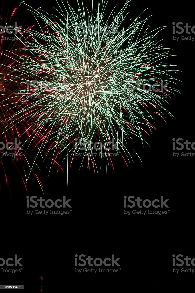 Nice big light blue and red fireworks over a lake royalty-free stock photo