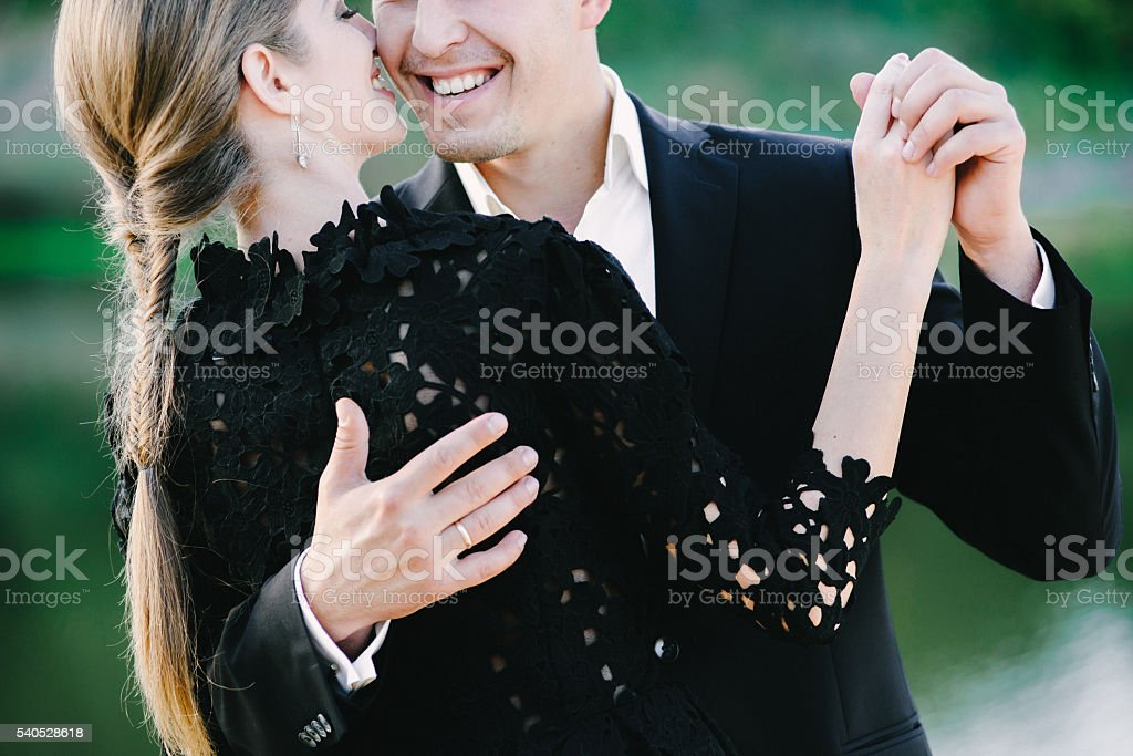 nice black dressed couple waltzing and laughin stock photo