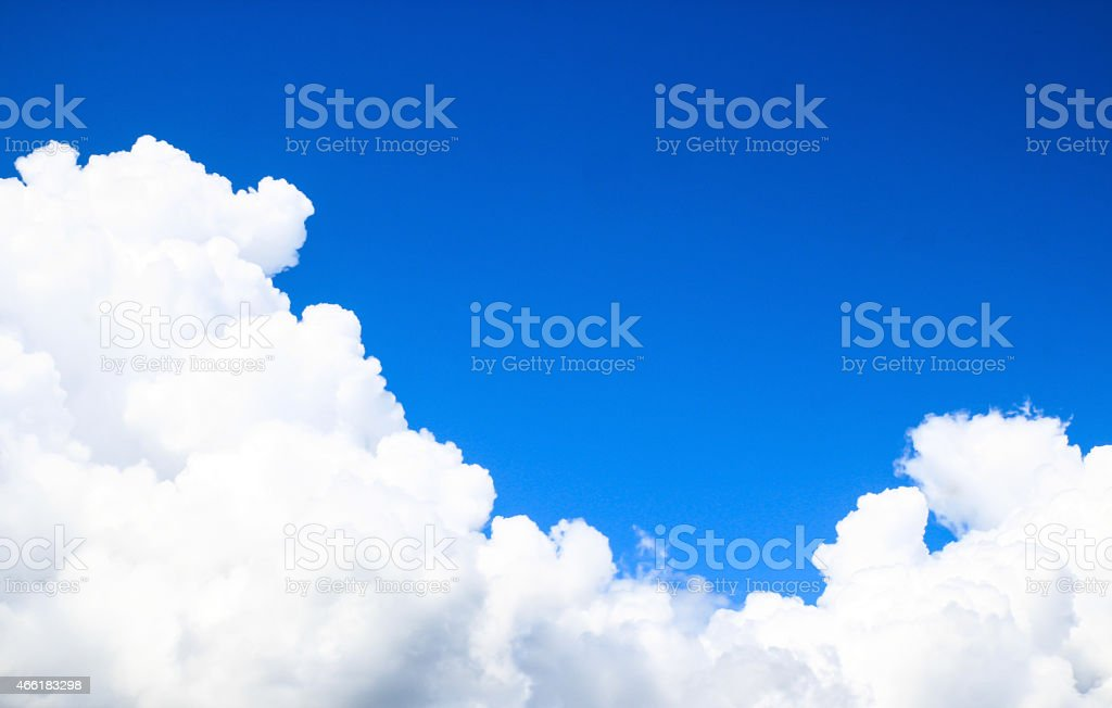 A nice blue sky with fluffy clouds stock photo