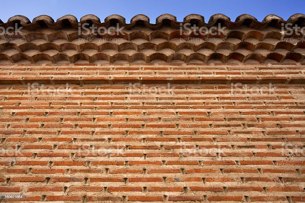 Nice Brick Wall with Roof Tiles royalty-free stock photo