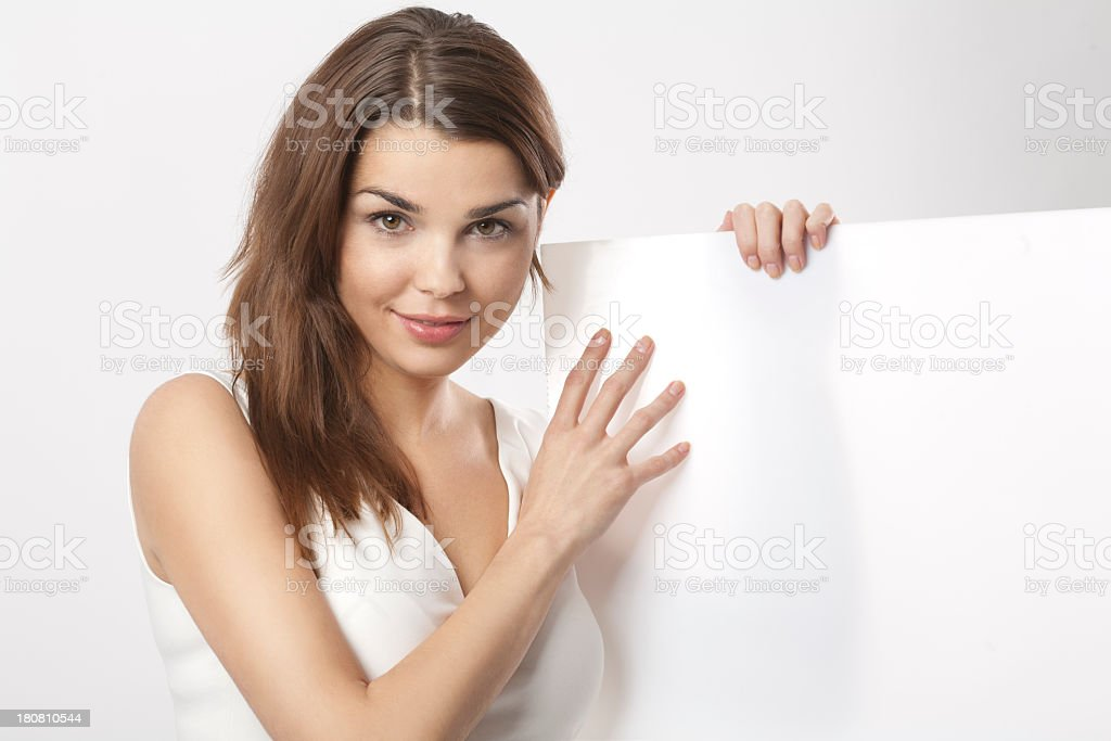 Nice brunette with blank poster royalty-free stock photo