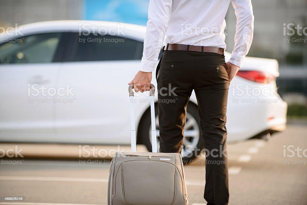 Nice businessman holding suitcase stock photo