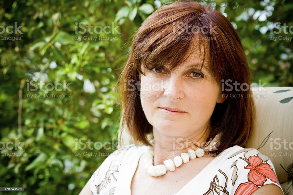 nice cheerfull mature woman stock photo
