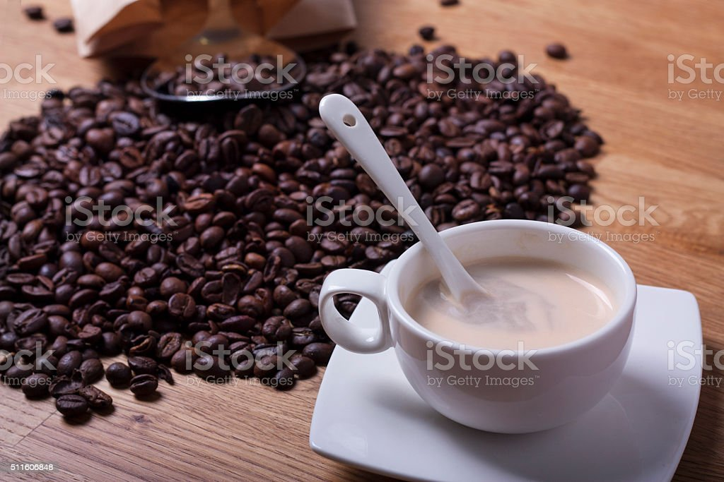 Nice coffee beans over an oak table stock photo