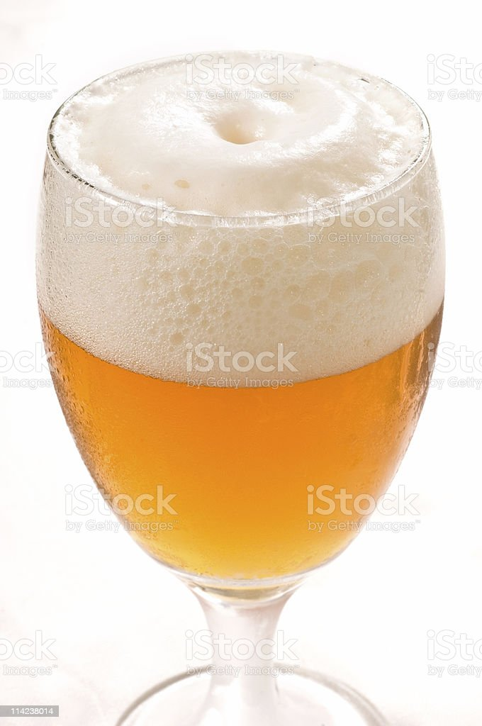 A nice cold and foamy beer in a glass. stock photo