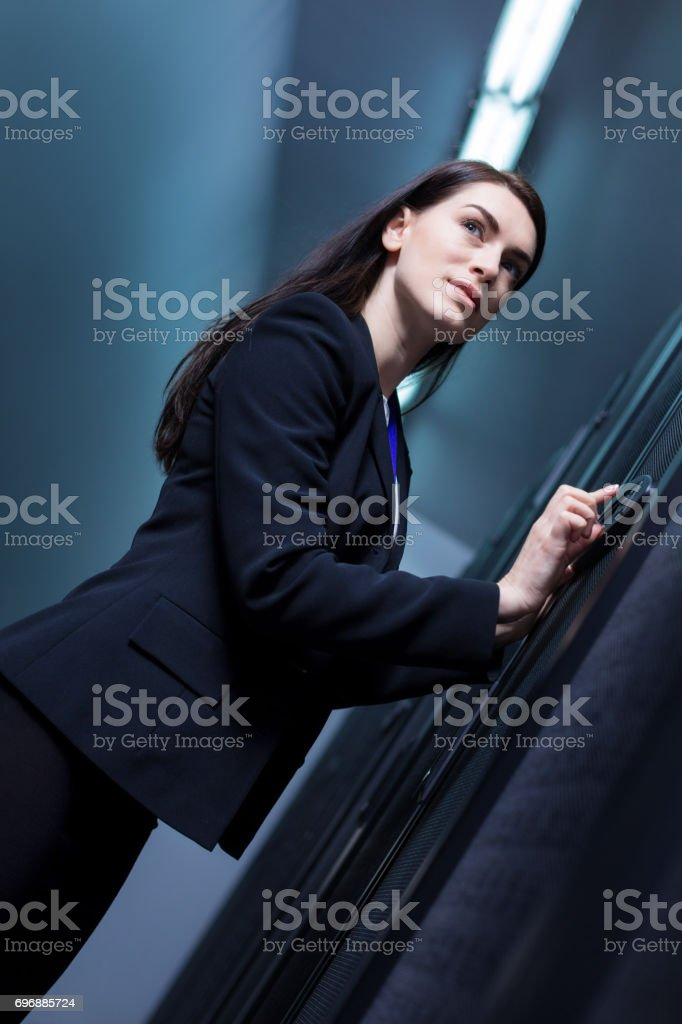 Nice confident woman pressing the button stock photo