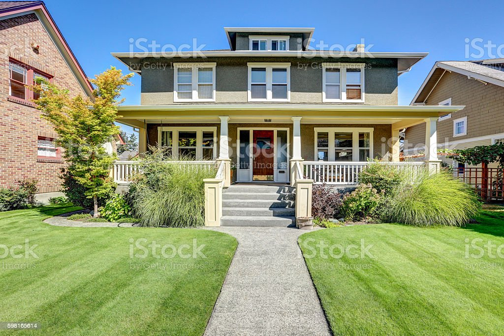 Nice curb appeal of American craftsman style house. stock photo