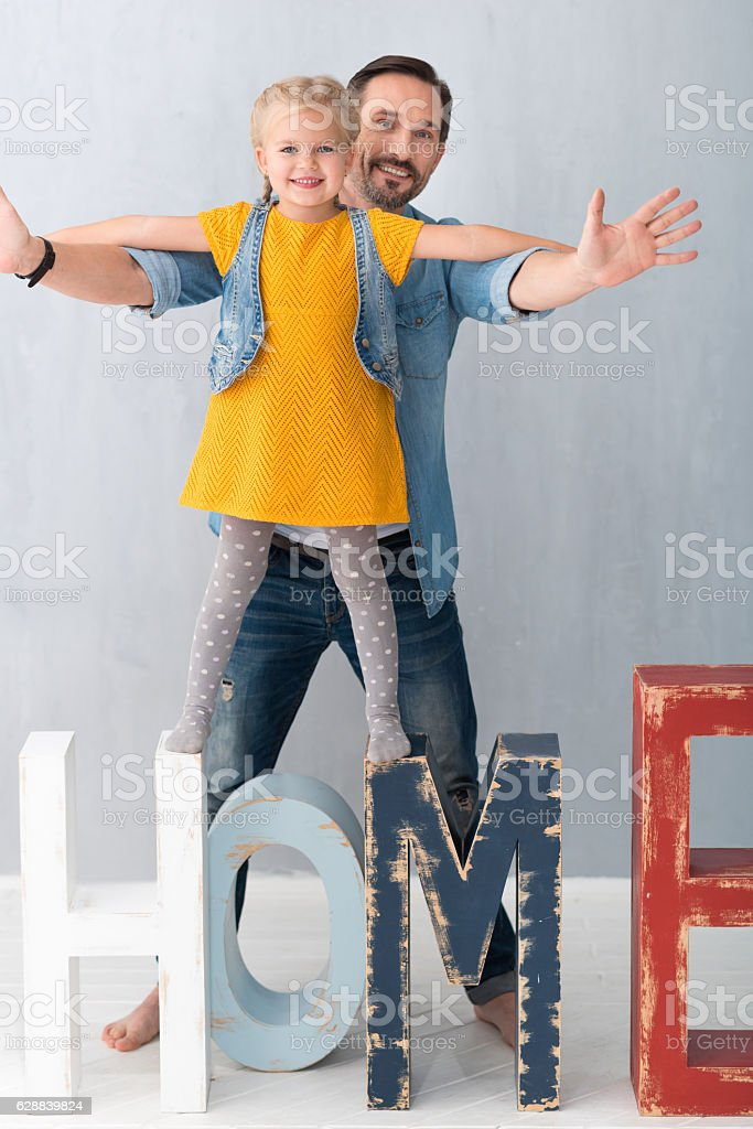 Nice cute girl holding on to the father stock photo