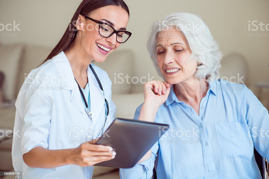 Nice doctor with senior patient stock photo