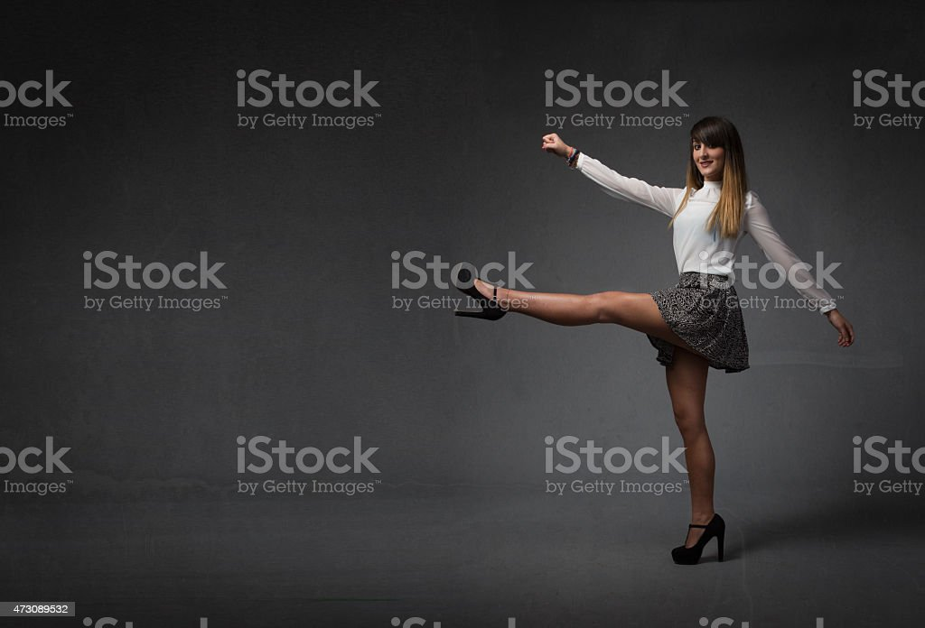 nice girl moving legs like majorette stock photo