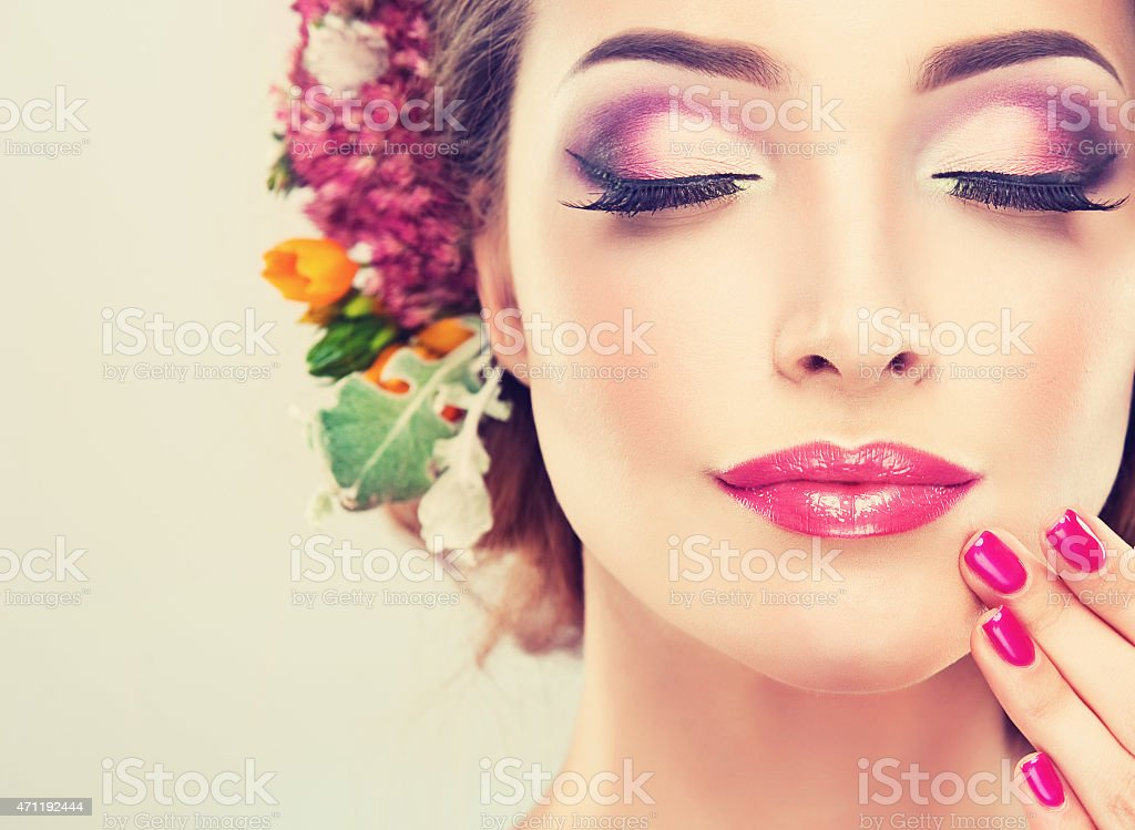 Nice Girl with delicate flowers in hair stock photo
