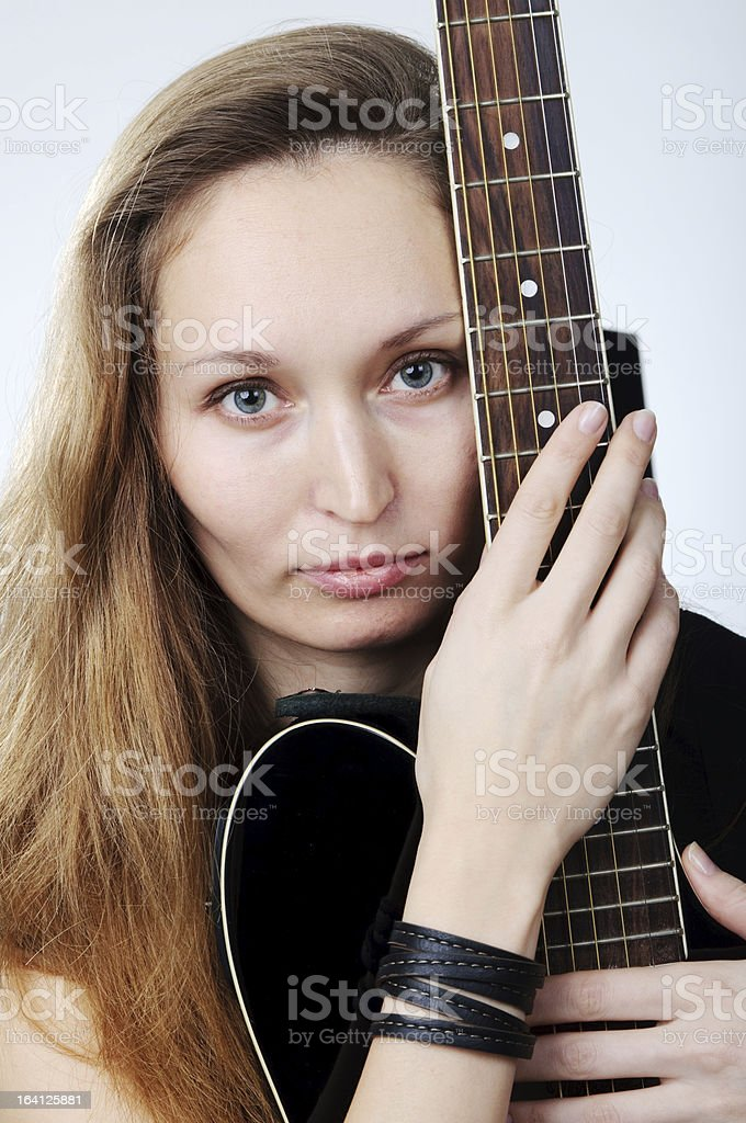 Nice girl with guitar royalty-free stock photo