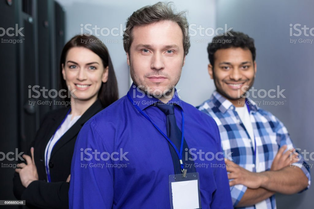 Nice good looking man leading his team stock photo