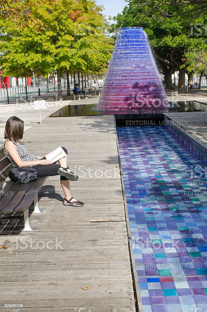 Nice looking woman reading in Park of Nations stock photo