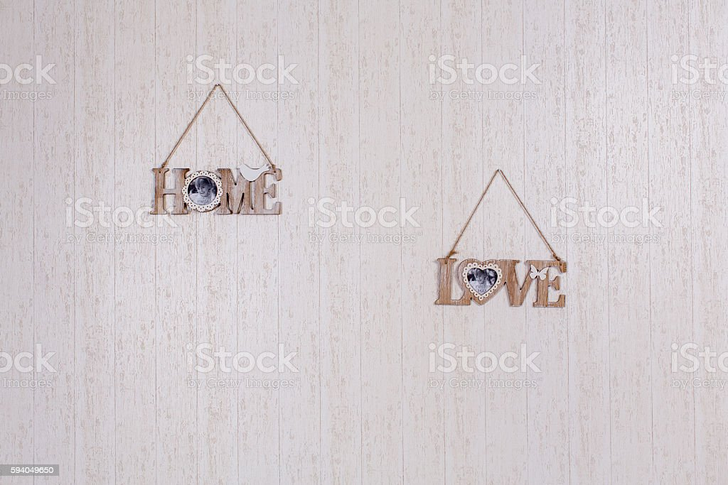 Nice plates on wooden wall stock photo