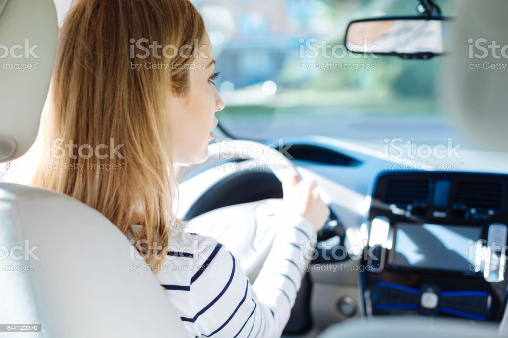 Nice pleasant woman looking at the road stock photo