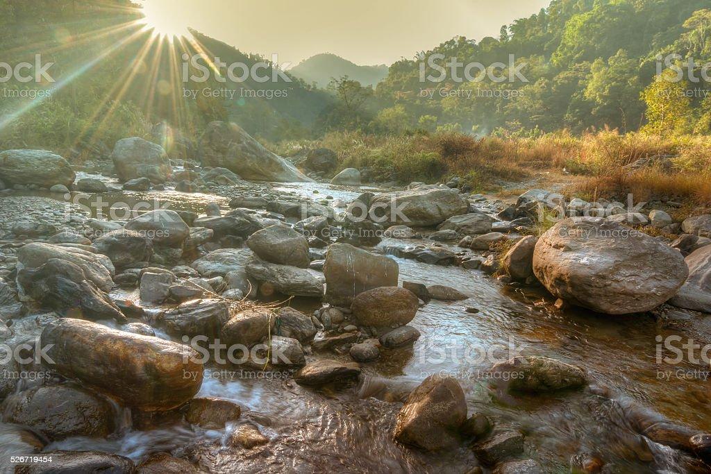 Nice river water flowing through rocks at dawn stock photo