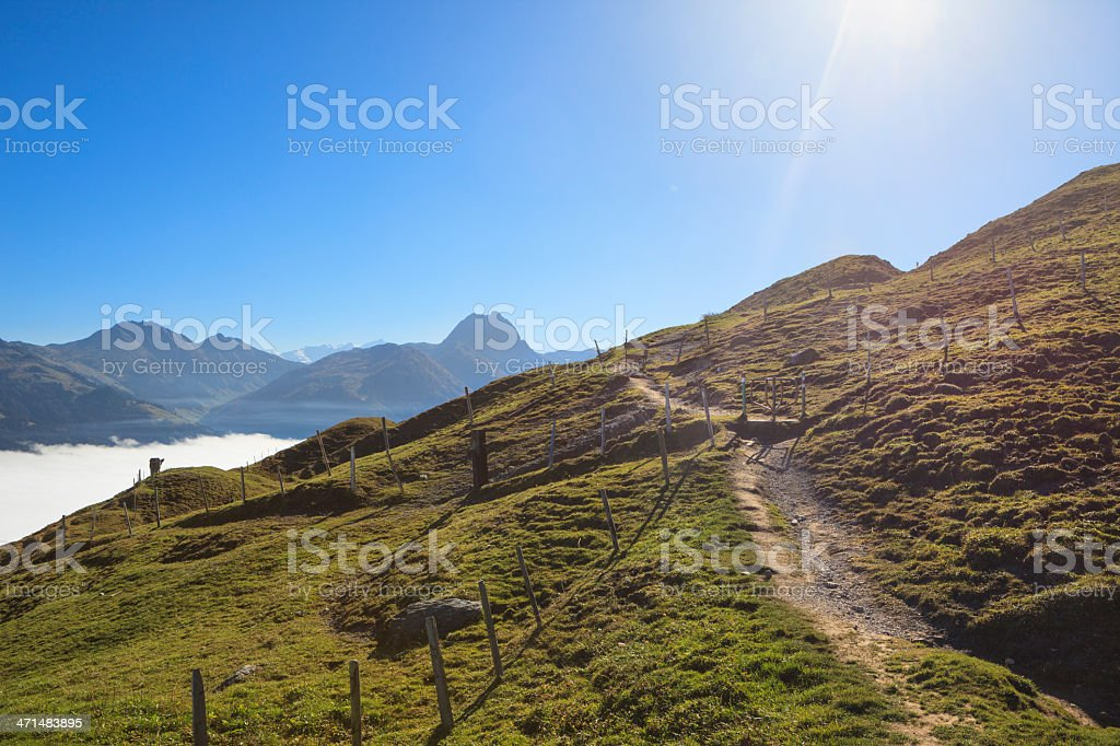 Nice sunny day on mountain with fog in the valley stock photo