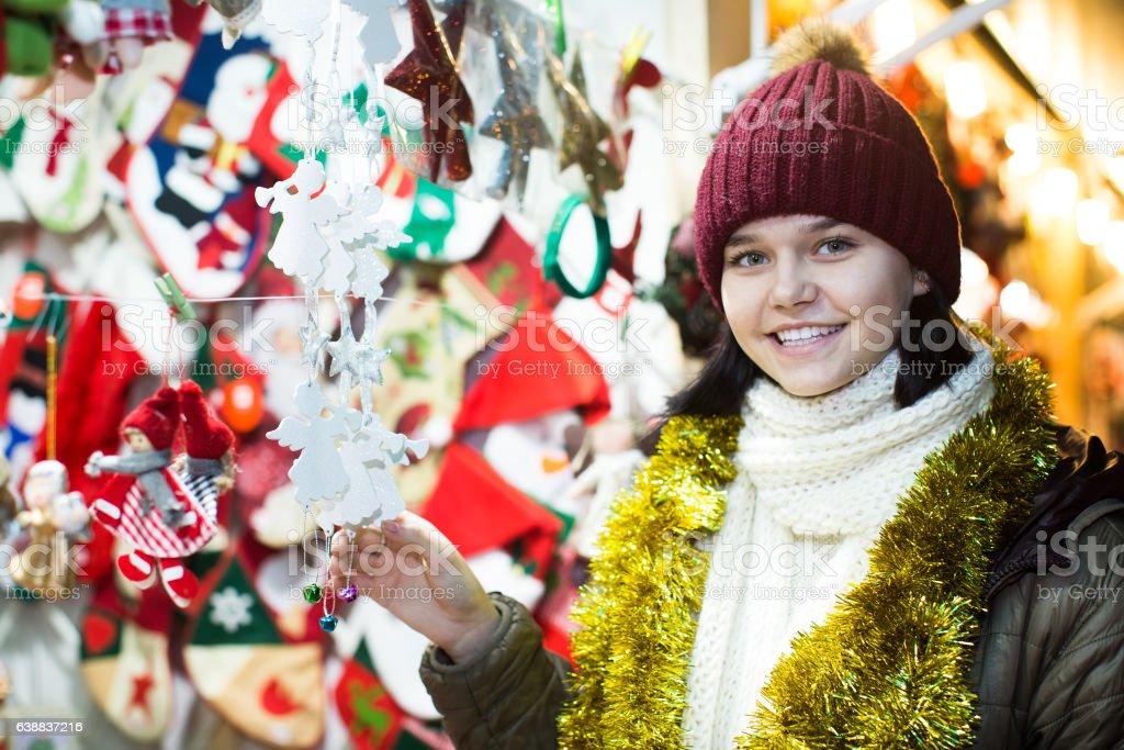 Nice teen girl with Christmas garlands stock photo