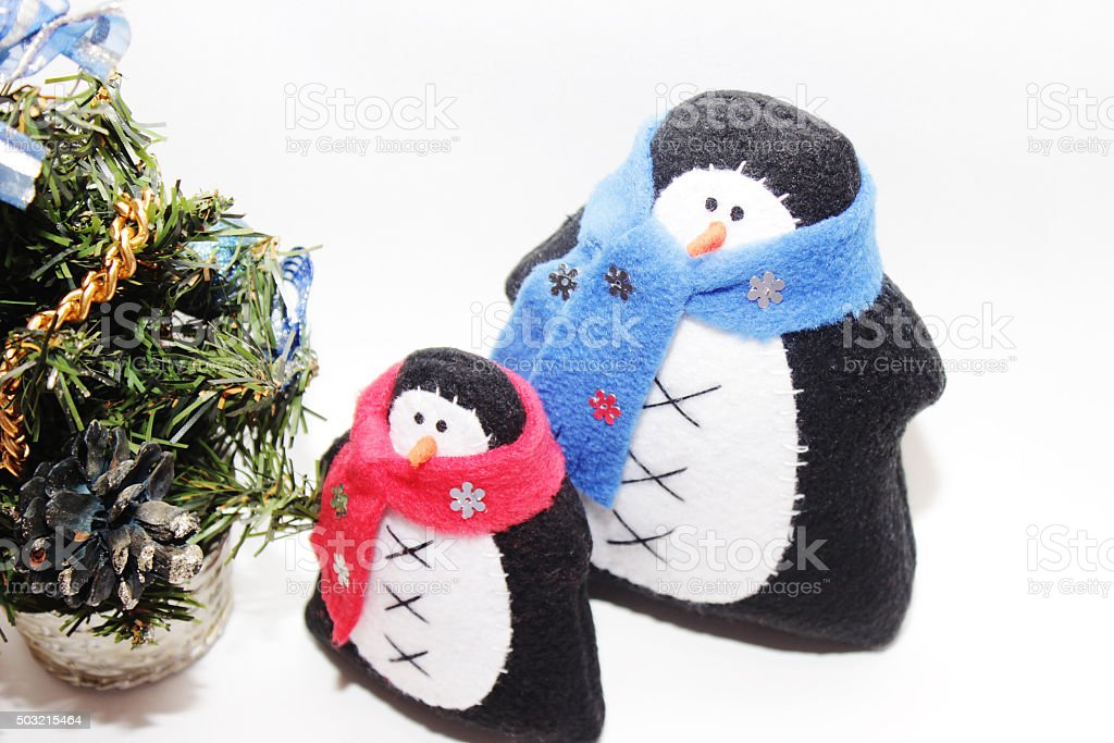 nice toys of handwork  penguins in scarf stock photo
