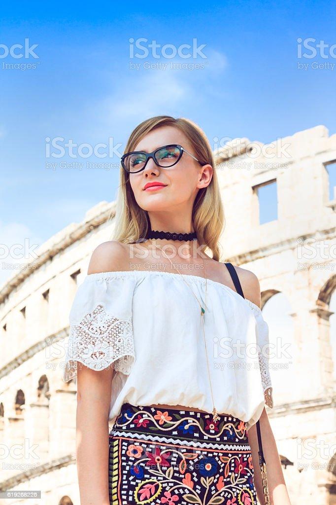 Nice woman around Roman arena stock photo