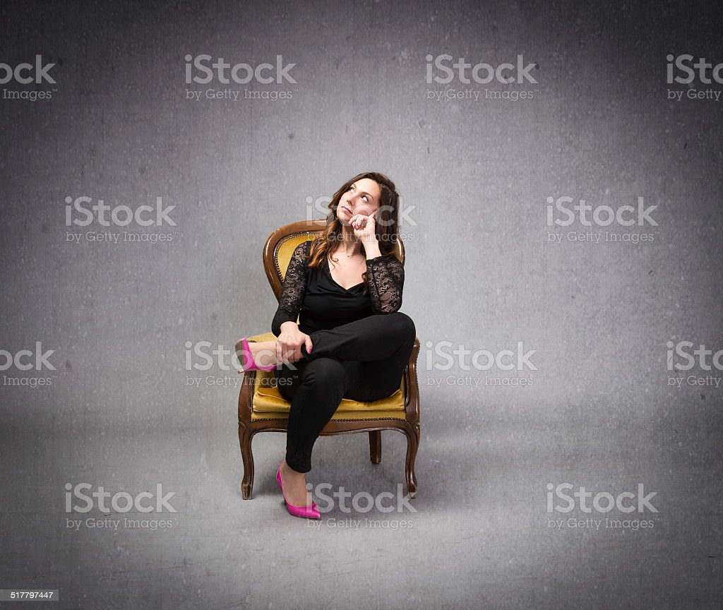 nice woman couch on yellow sofa with head up stock photo