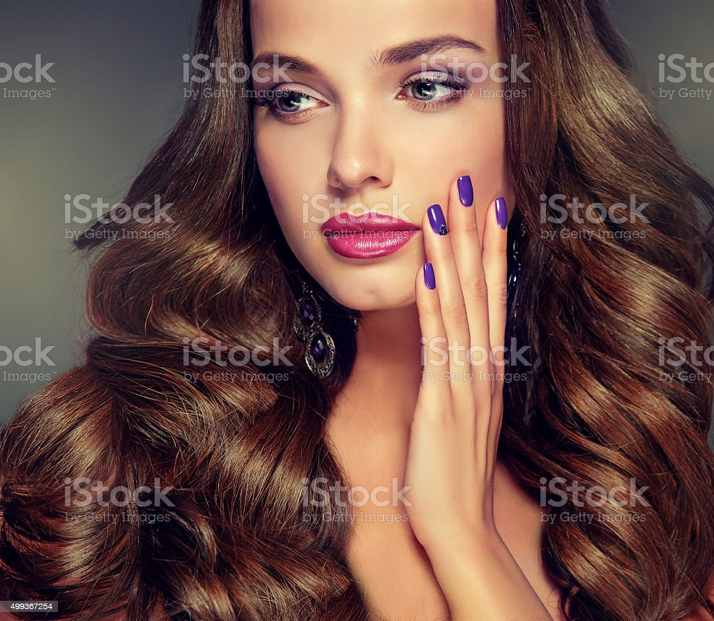 Nice young girl model with dense, curly hair. stock photo