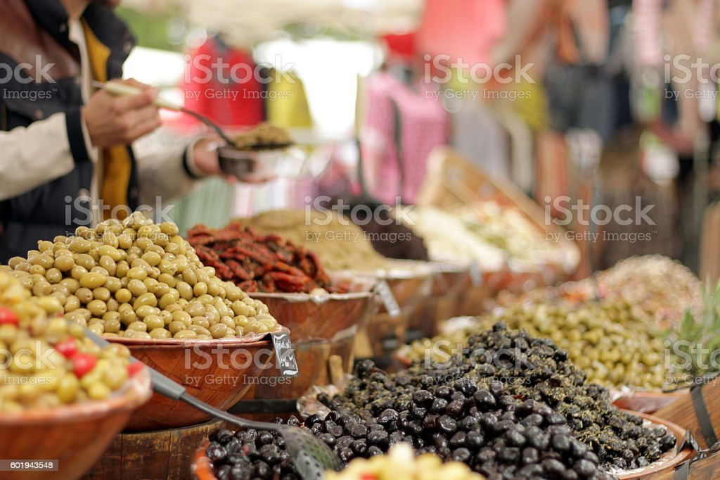 Nicely arranged heaps of olives at Arles Market, France stock photo