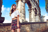 Nicely dressed woman around Roman arena