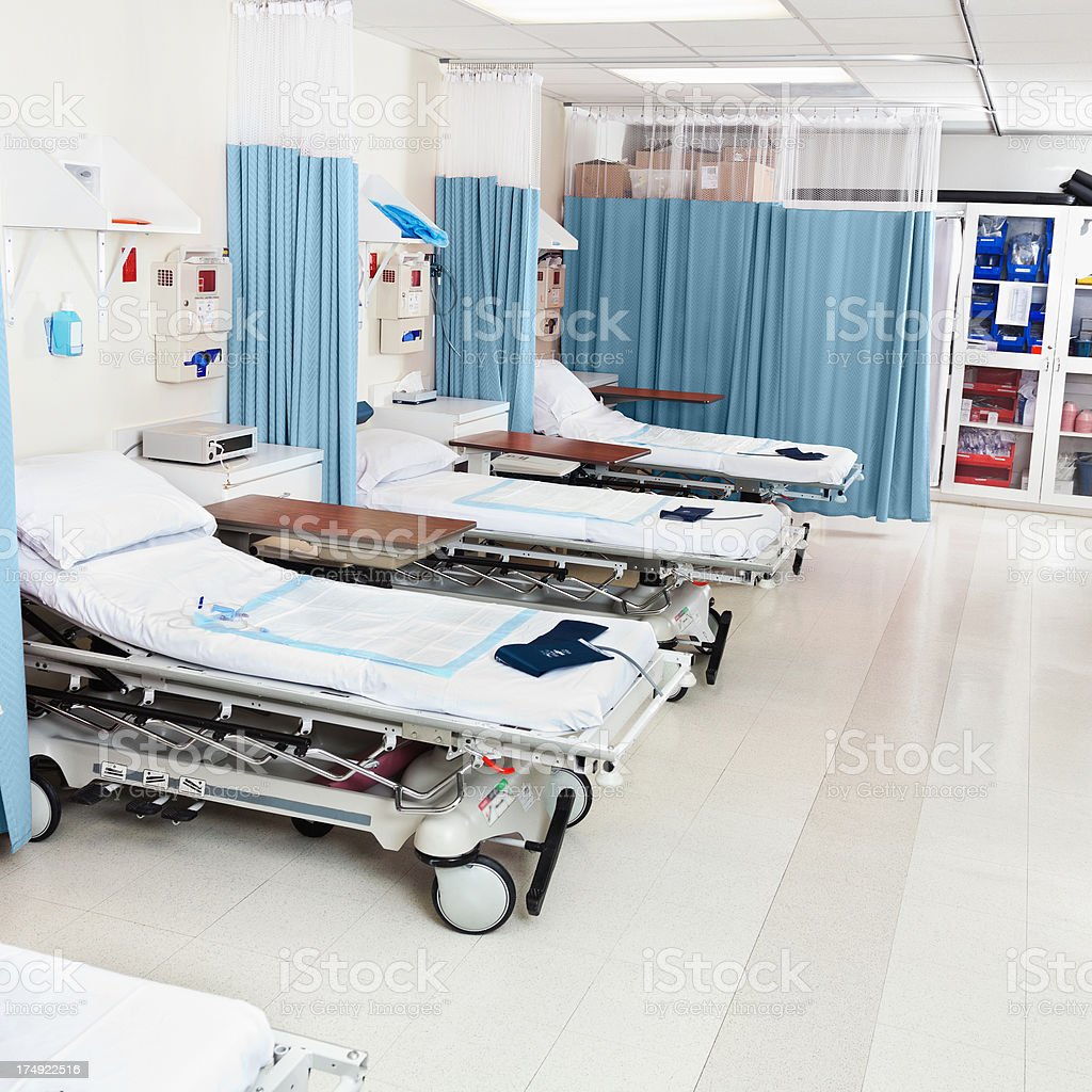 Nicely kept hospital beds in a surgery recovery area stock photo