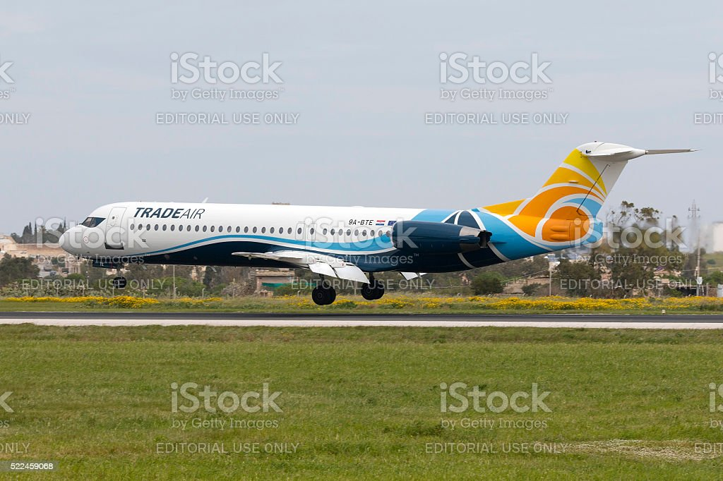 Nicely painted Fokker 100 on approach stock photo
