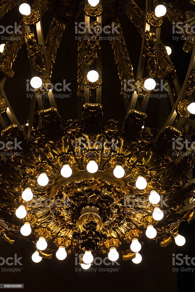 Nickel and gold plated chandelier stock photo