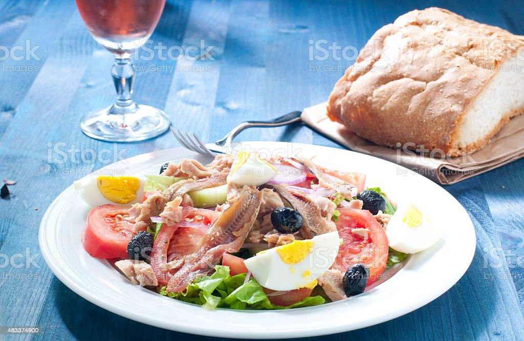 Nicoise salad with egg , anchovies , onions , lettuce and tuna stock photo
