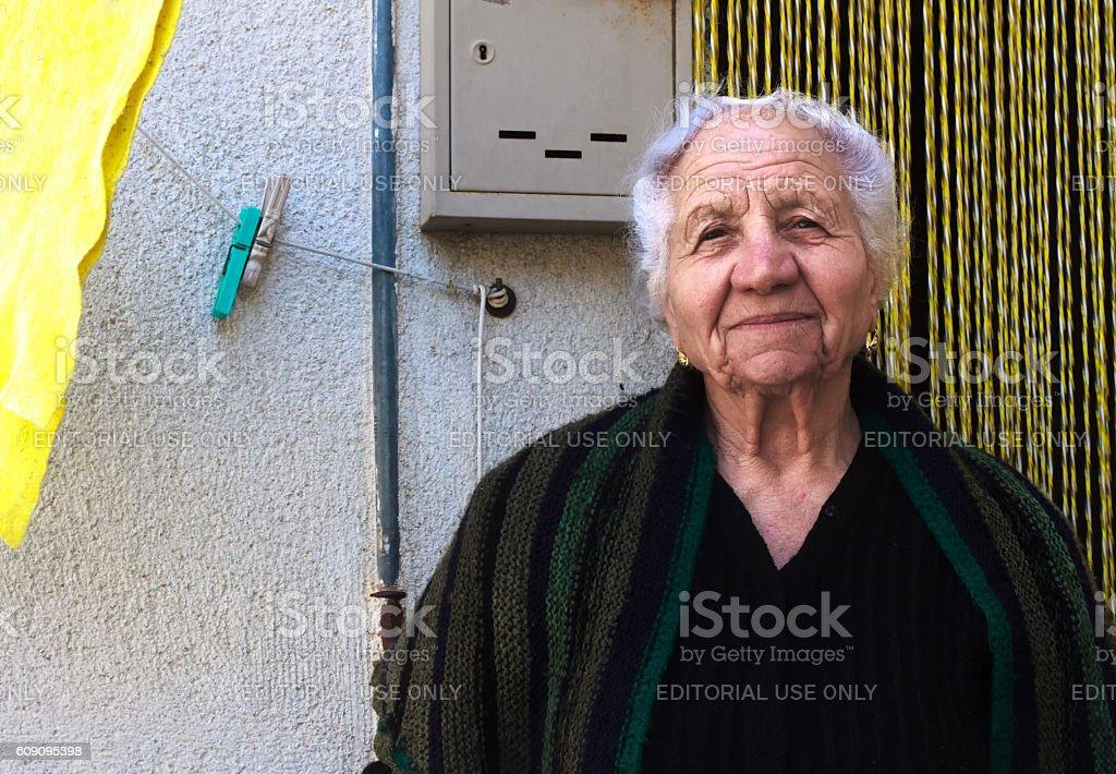 Nicosia, Sicily: Portrait of Senior Woman Near Beaded Curtain stock photo