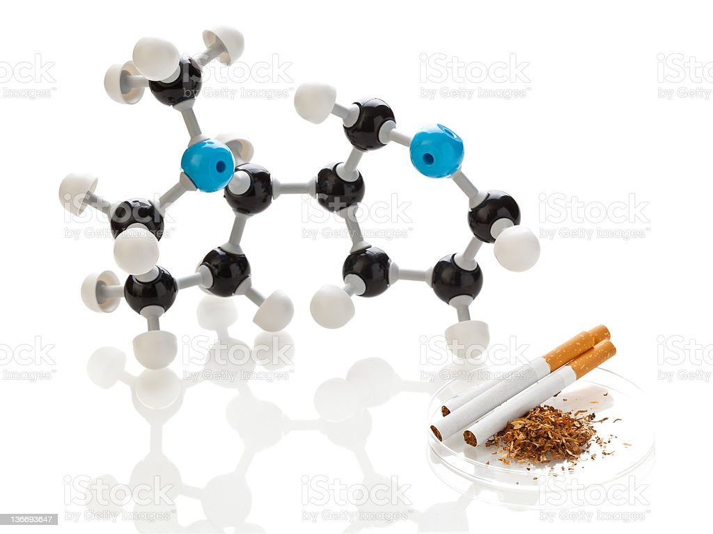 Nicotine molecule with tobacco and cigarettes royalty-free stock photo