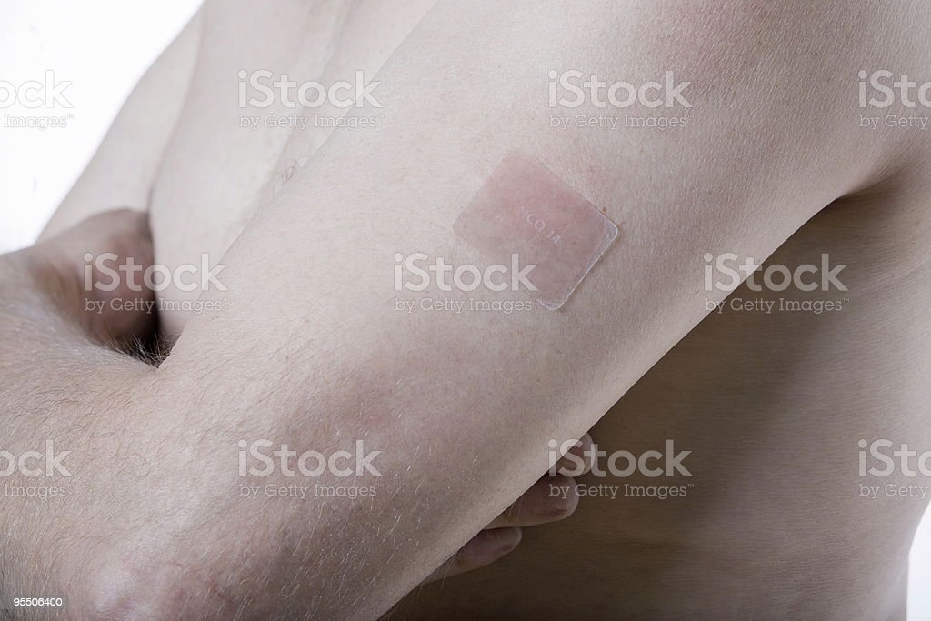 nicotine patch  senior man arm detail royalty-free stock photo