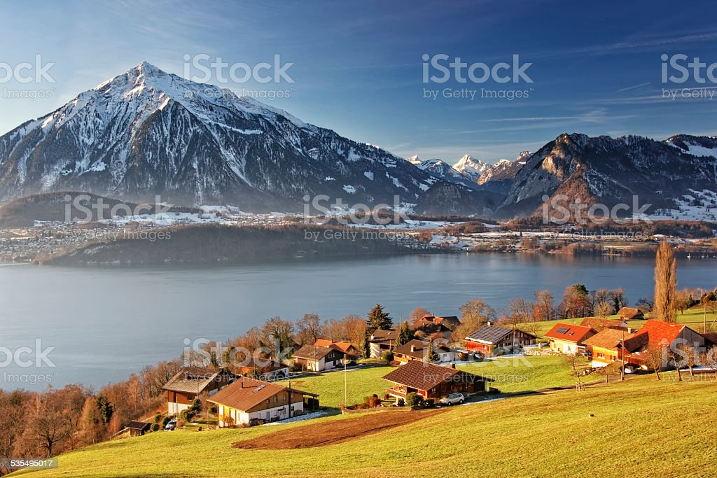 Niesen and other Swiss Alps mountains and lake view stock photo