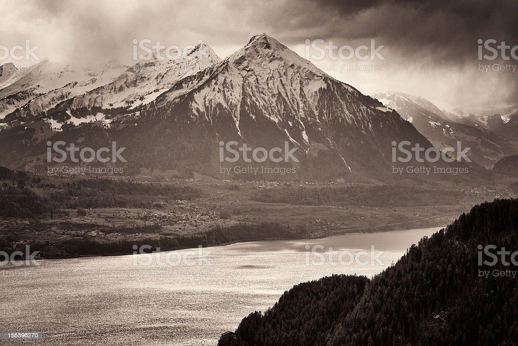 Niesen Mountain above the Lake of Thun in Spring, monochromatic stock photo