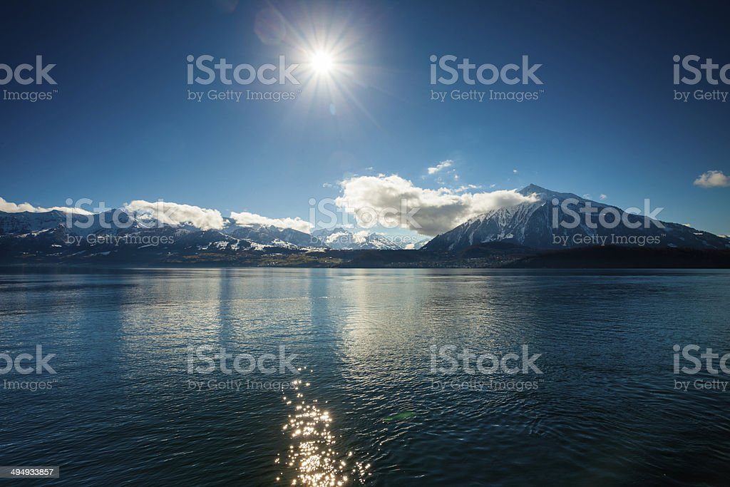 Niesen Peak and lake Thun of Swiss Alps stock photo