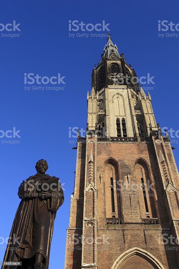 Nieuwe Kerk with the statue of Hugo Grotius in front royalty-free stock photo