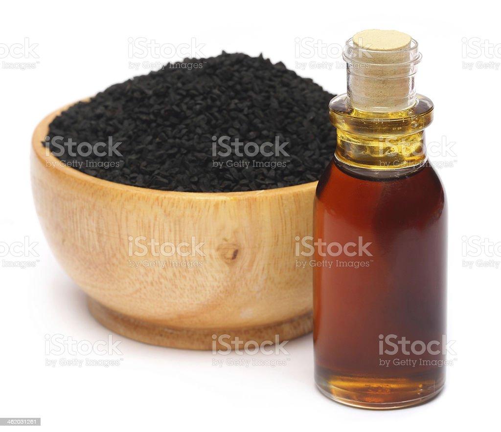 Nigella sativa or Black cumin with essential oil stock photo
